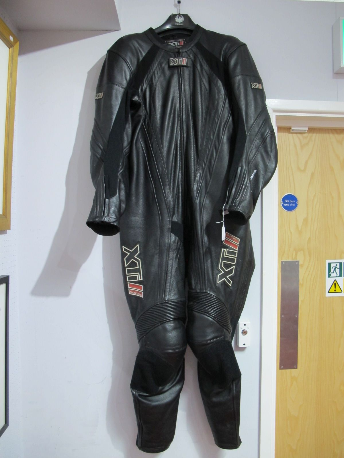 Lot 13 - Modern One Piece Motorbike black leathers with stretch panels and body armour, size 46 by Frank