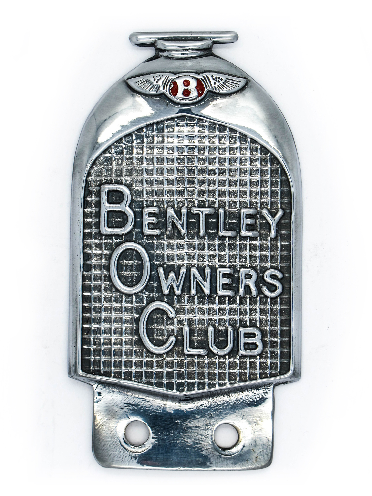 "Lot 21A - A 1930's Red Label Bentley Owner's Club Chrome Bumper Badge, plated bronze, circa 4.5"" x 2.5""."