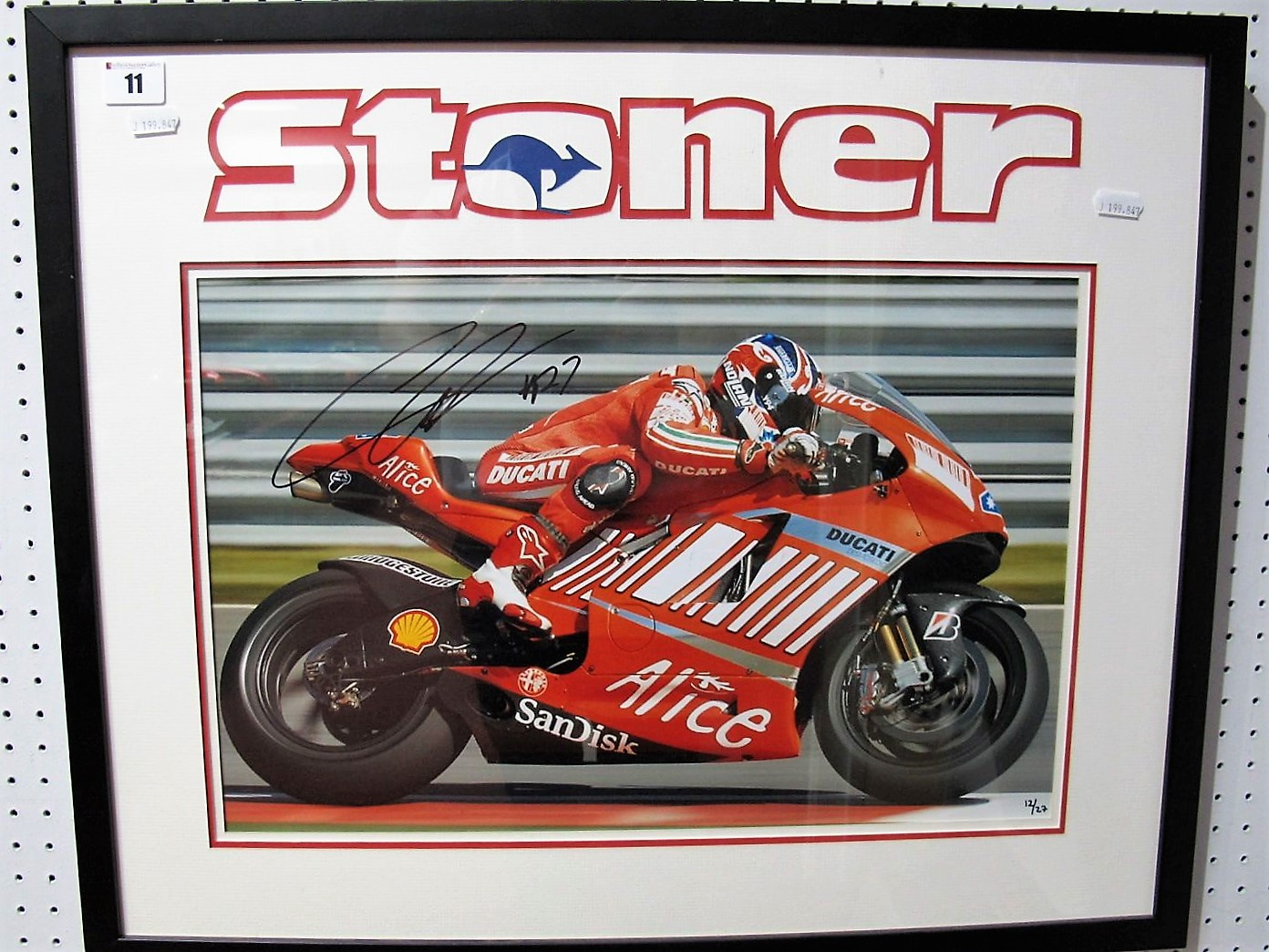 Lot 11 - Casey Stoner Signed Ltd Edition Print, with Stoner logo, framed 12/27 (27 being his racing No), 2007