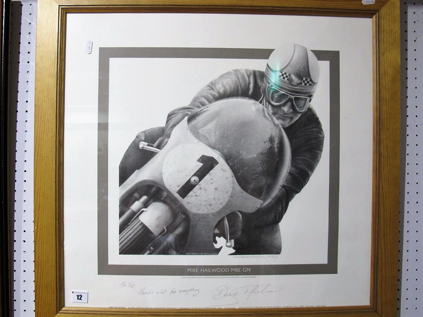 Lot 12 - After Christopher Marshall- 'Mike Hailwood MBE, GM, graphite signed by artist and Dave Hailwood (