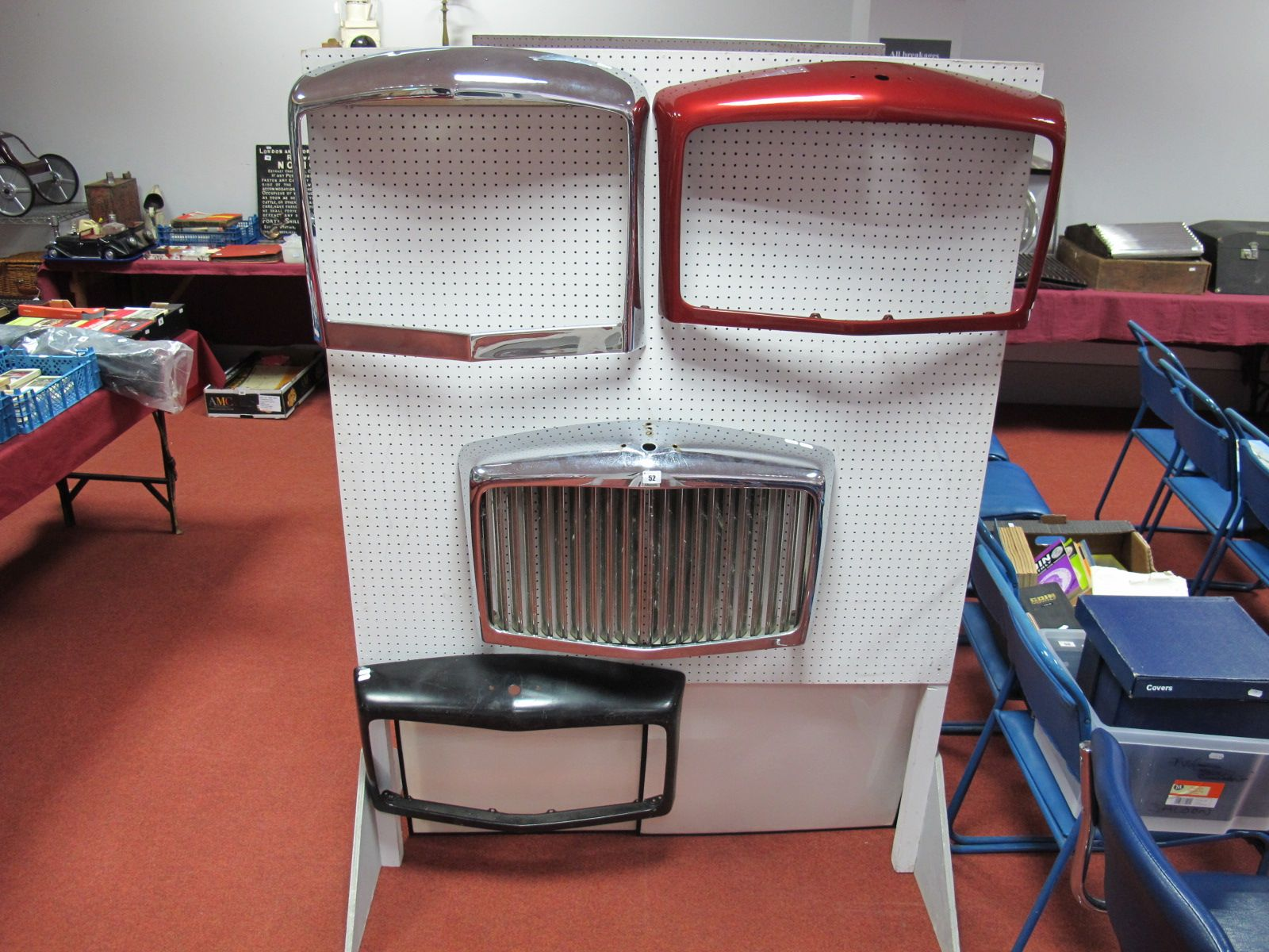 Lot 52 - Three Bentley Front Grill Surrounds, chrome, red, black and one other front grill surround.