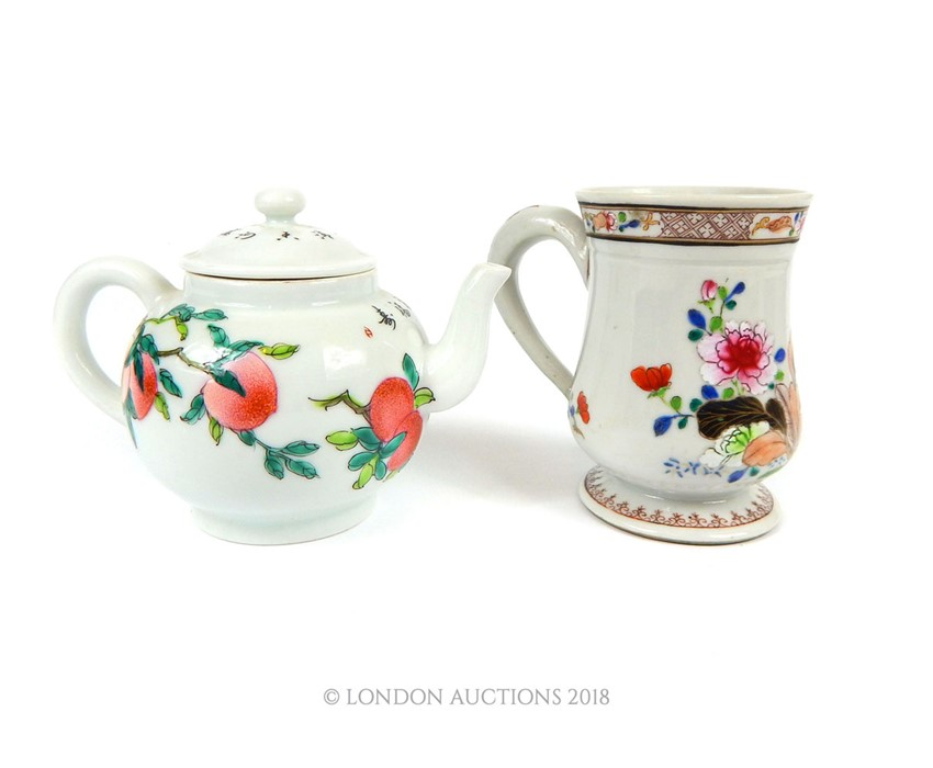 Lot 33 - A Chinese famille rose porcelain mug and teapot