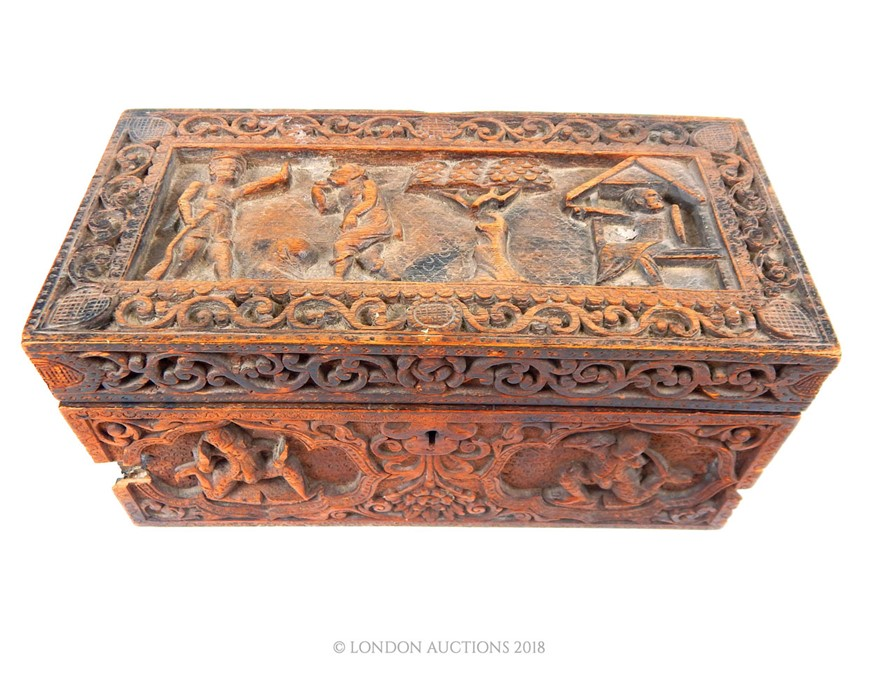Lot 31 - An early 20th century Indian carved wood box