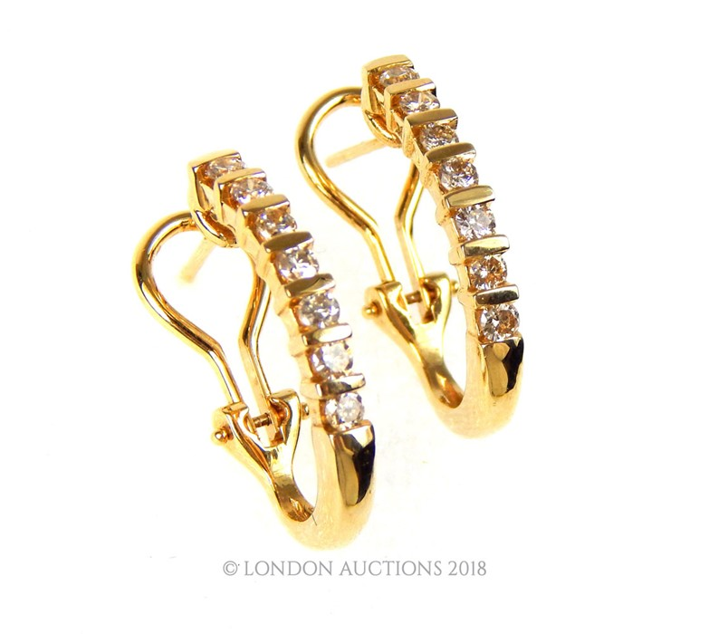 Lot 49 - A pair of 14 Carat Yellow Gold Half Loop Earrings.