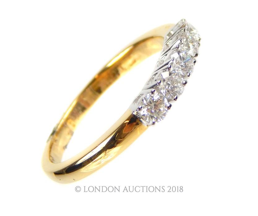 Lot 28 - An 18 Carat Yellow Gold and Diamond set Half Eternity Ring.