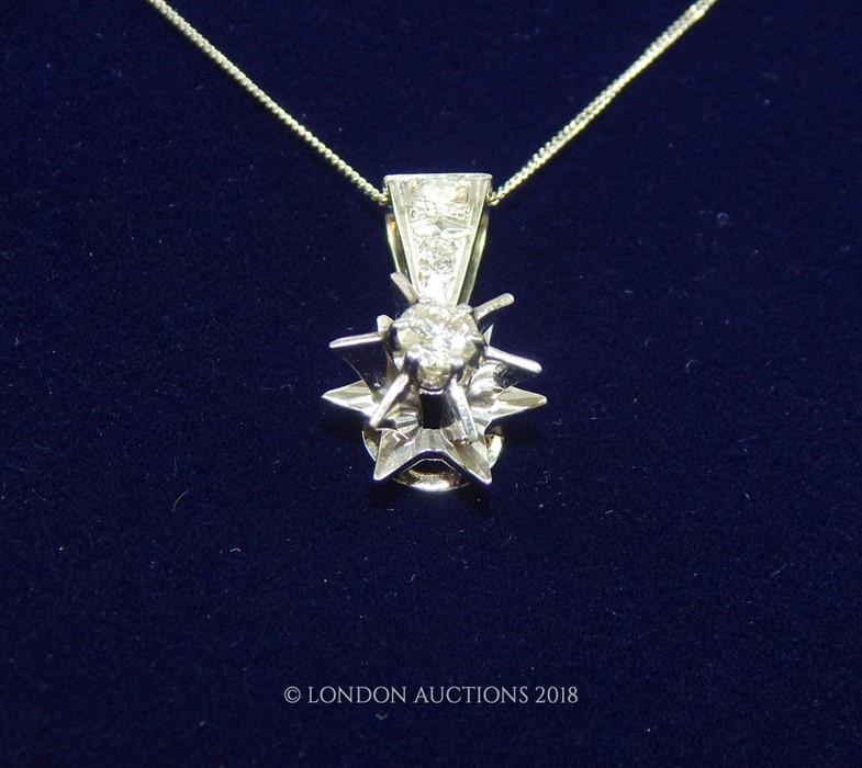 Lot 53 - An 18 Carat White Gold Diamond Star Shaped Pendant Necklace