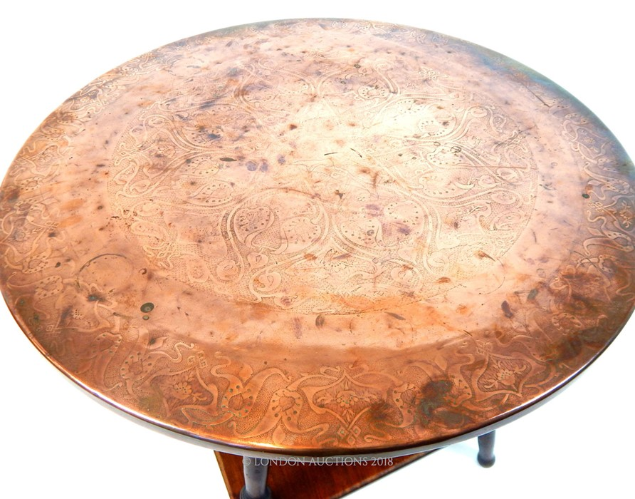 Lot 22 - A late Victorian Arts & Crafts table, with a copper circular top