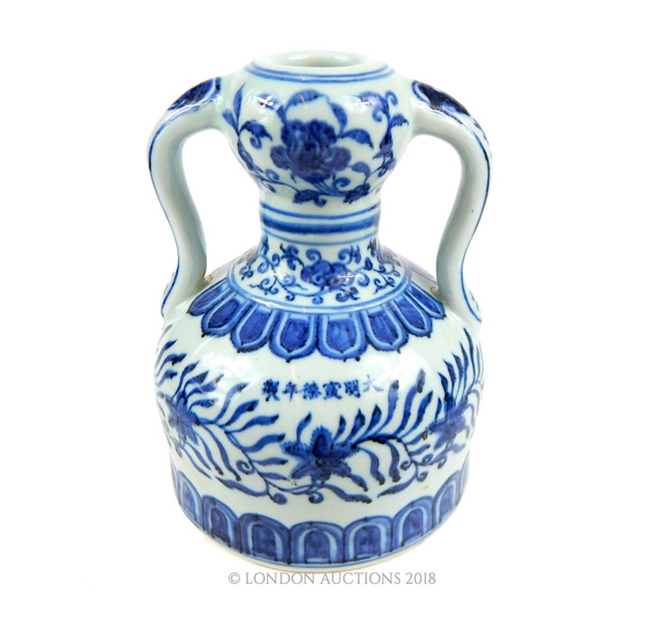 Lot 47 - A Chinese Ming style twin handled blue and white porcelain vase