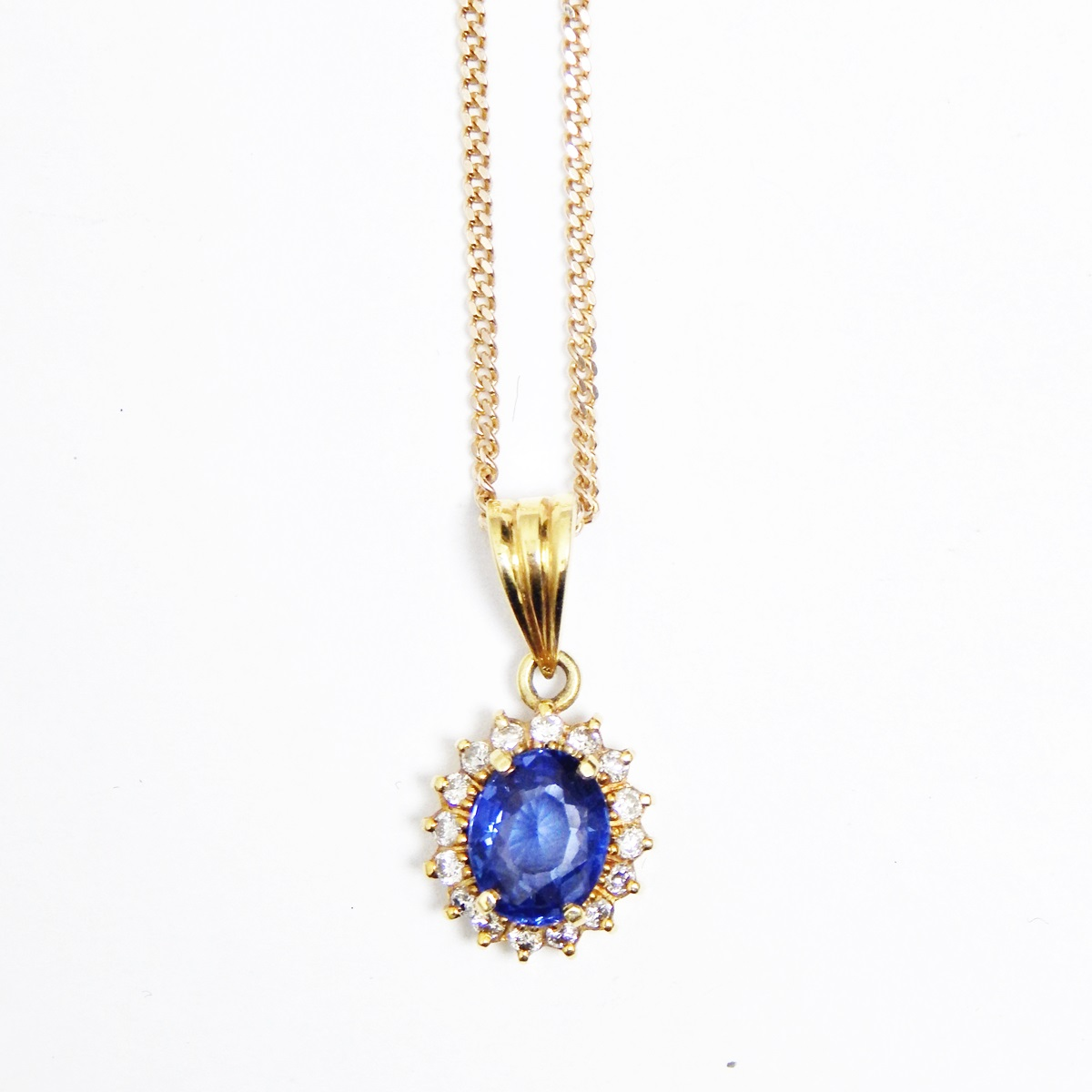 Gold, sapphire and diamond pendant, oval, set oval ...