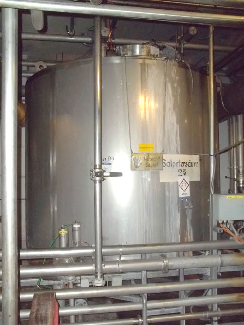 Lot 190 - Tank, Approximate 12000 Liter (3170 Gallon), Stainless Steel, Vertical. Coned bottom. Mounted on