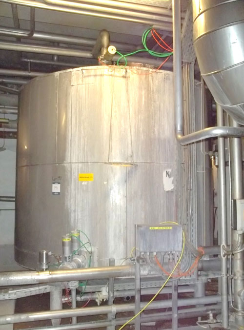 Lot 191 - Tank, Approximate 12000 Liter (3170 Gallon), Stainless Steel, Vertical. Coned bottom. Mounted on