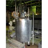 Unbranded stainless steel tank. 900 mm dia x 1000 st. side. Agitator driven by a Baumuller 0.75Kw/