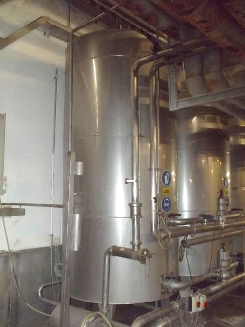 Lot 195 - Tank, Approximate 7500 Liter (1981 Gallon), Stainless Steel, Vertical. Coned bottom. Mounted on 3