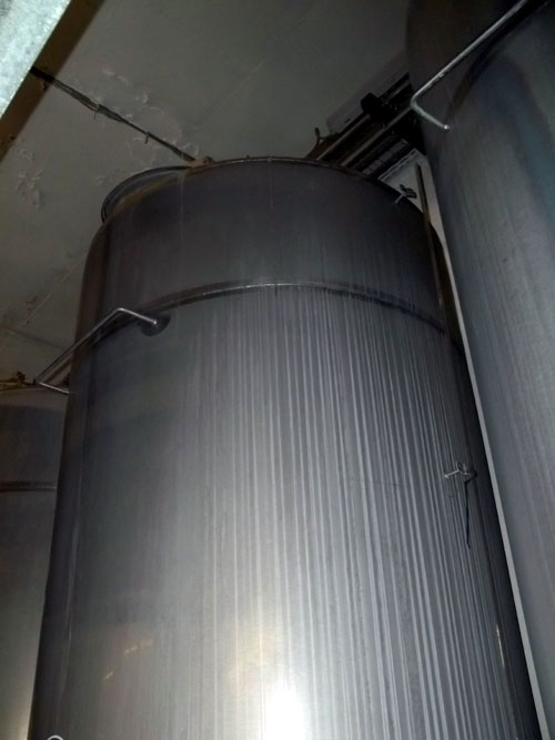 Lot 198 - Tank, Approximate 7500 Liter (1981 Gallon), Stainless Steel, Vertical. Coned bottom. Mounted on 3