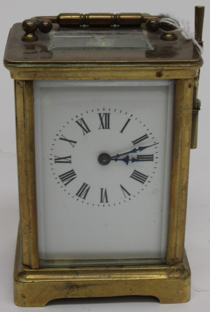 Brass carriage clock, white enamel face, Roman numerals