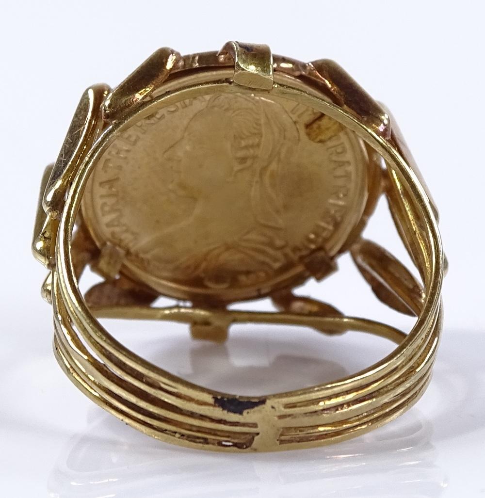 Lot 57 - An Austrian 1760 gold restrike Thaler gold ring, o