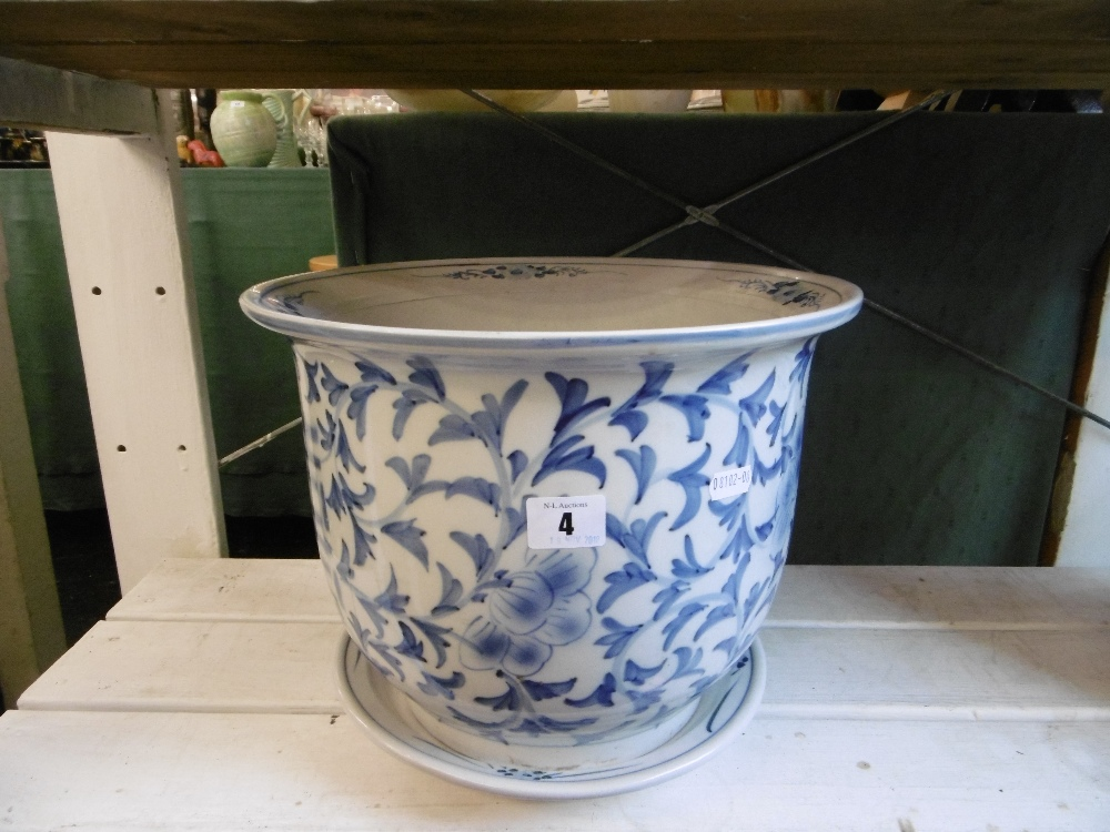 Lot 4 - A BLUE AND WHITE PLANTER