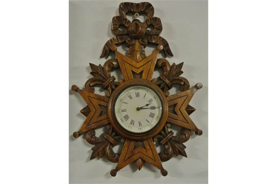 CLOCKS - An unusual wall mounted antique clock with French