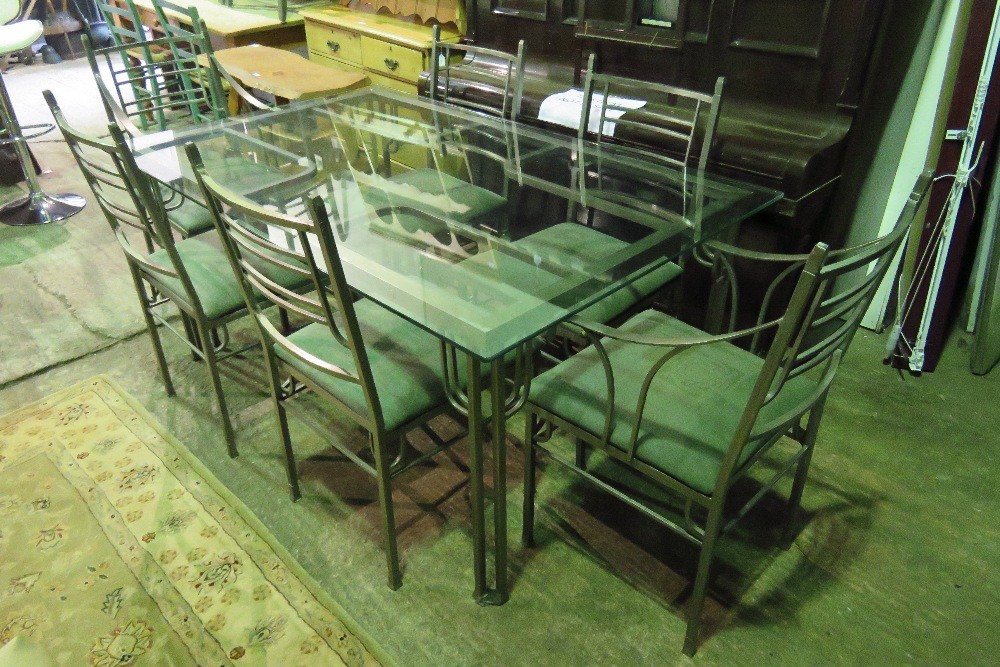 Lot 763 - A contemporary metal framed dining table