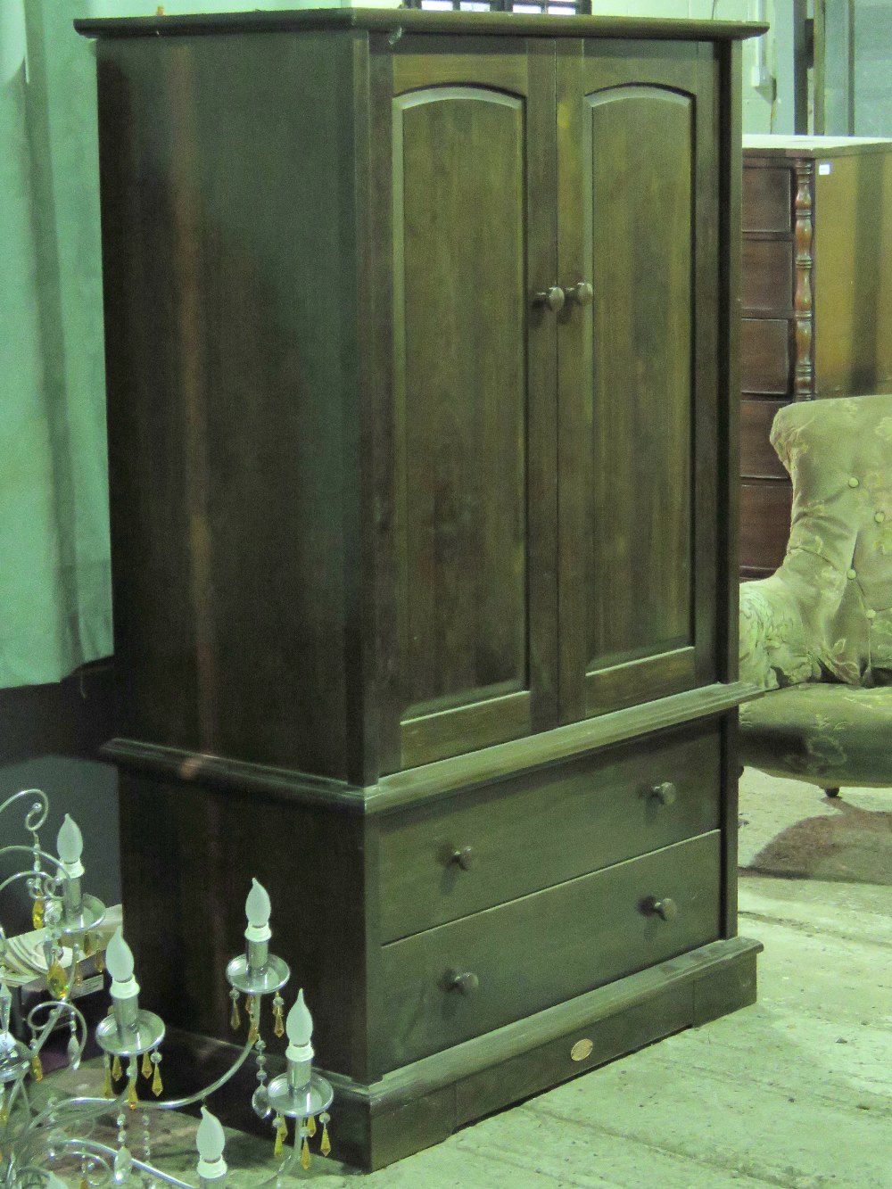 Lot 806 - A wardrobe having two doors over two dra