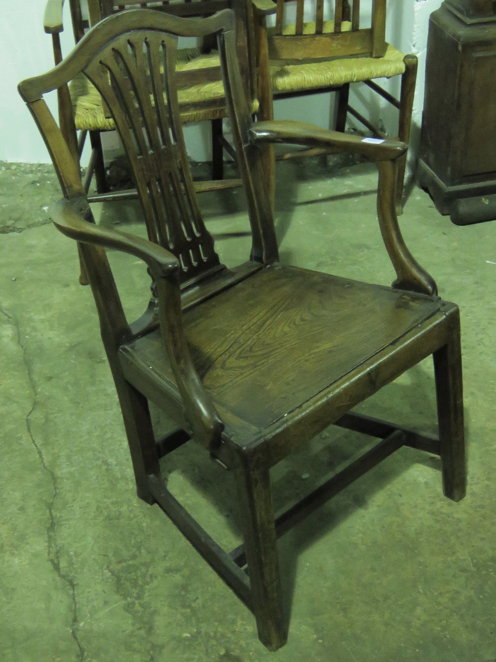 Lot 795 - A single solid seat open arm gentleman's