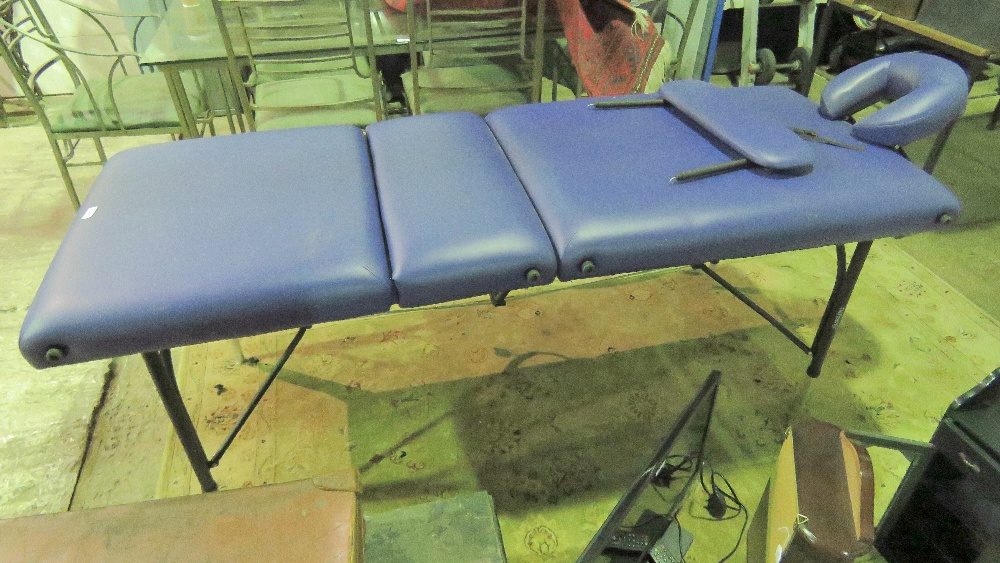 Lot 788 - A purple leatherette massage table.