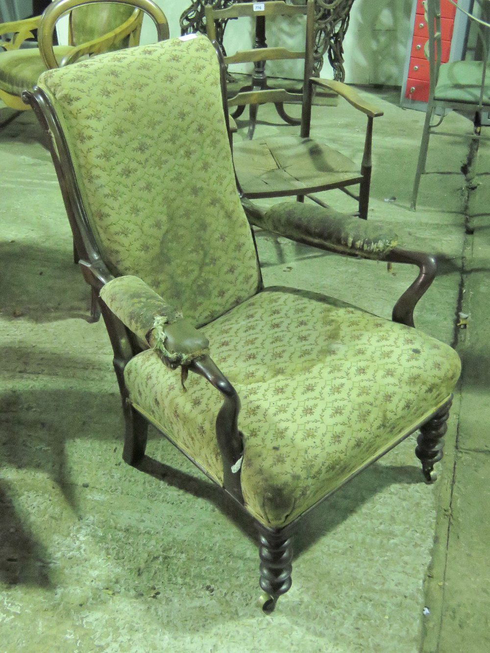 Lot 786 - An Edwardian high back elbow chair for r