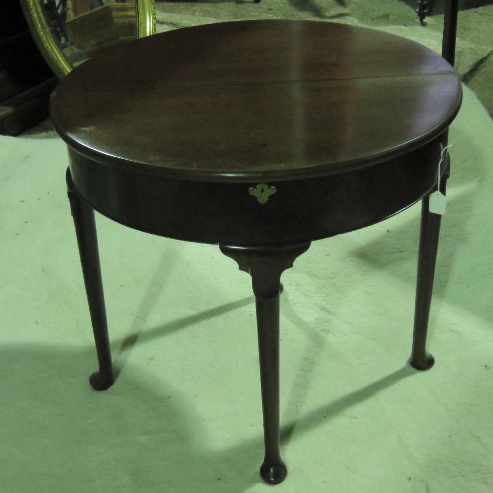 Lot 798 - A mahogany demi-lune fold over tea table