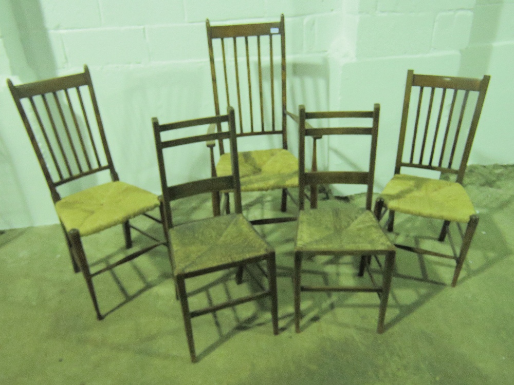 Lot 758 - A rush seated elbow chair with ash frame