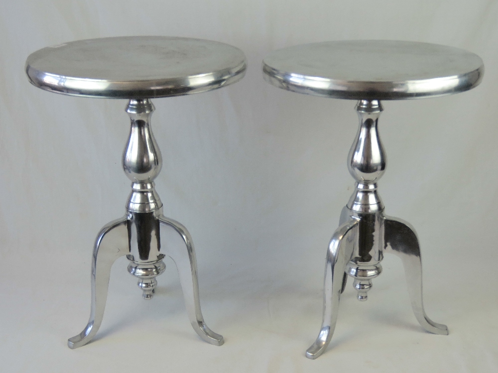 Lot 760 - A pair of contemporary polished steel ci