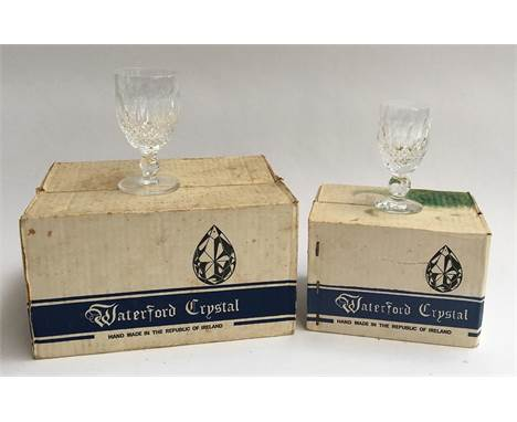 A boxed set of six Waterford Colleen cut crystal wine glasses; together with a boxed set of six matching Waterford crystal sh