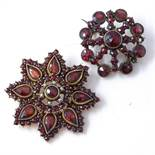 2 Victorian gilt metal garnet cluster brooches, one set with split pearls and rose-cut garnets,
