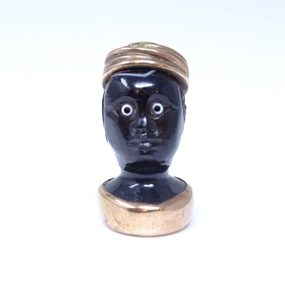 A 19th century banded agate figural Blackamoor seal fob, unmarked rose gold mounts with cabochon - Image 3 of 5
