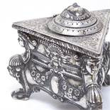 A 19th century Austro-Hungarian cast-silver inkwell, triangular form with Empire-style decoration,
