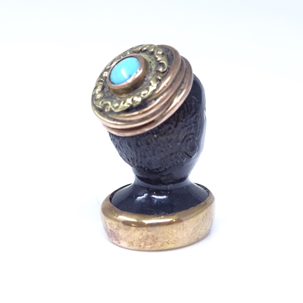 A 19th century banded agate figural Blackamoor seal fob, unmarked rose gold mounts with cabochon - Image 2 of 5