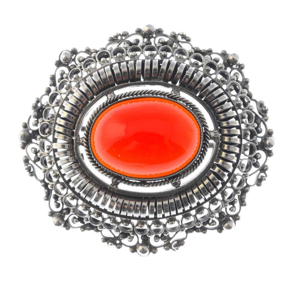 Lot 3 - A selection of silver and white metal jewellery. To include a carnelian filigree brooch of oval