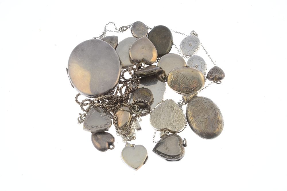Lot 15 - Twenty-three silver and white metal lockets. To include a silver locket of oval shape engraved