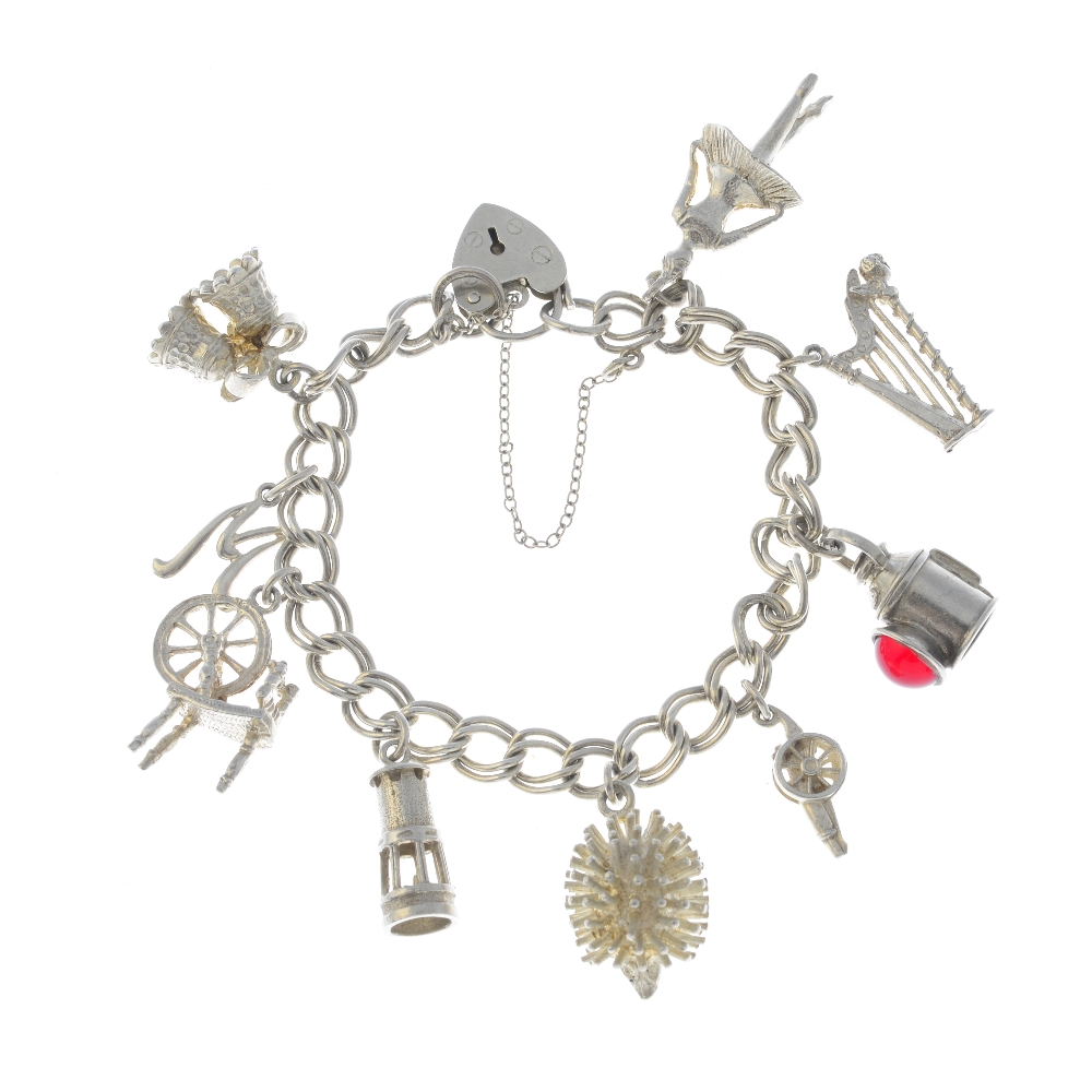 Lot 35 - A selection of silver and white metal jewellery. To include a silver charm bracelet with a heart
