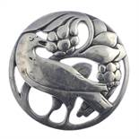 A selection of silver and white metal jewellery. To include a brooch of circular outline featuring a