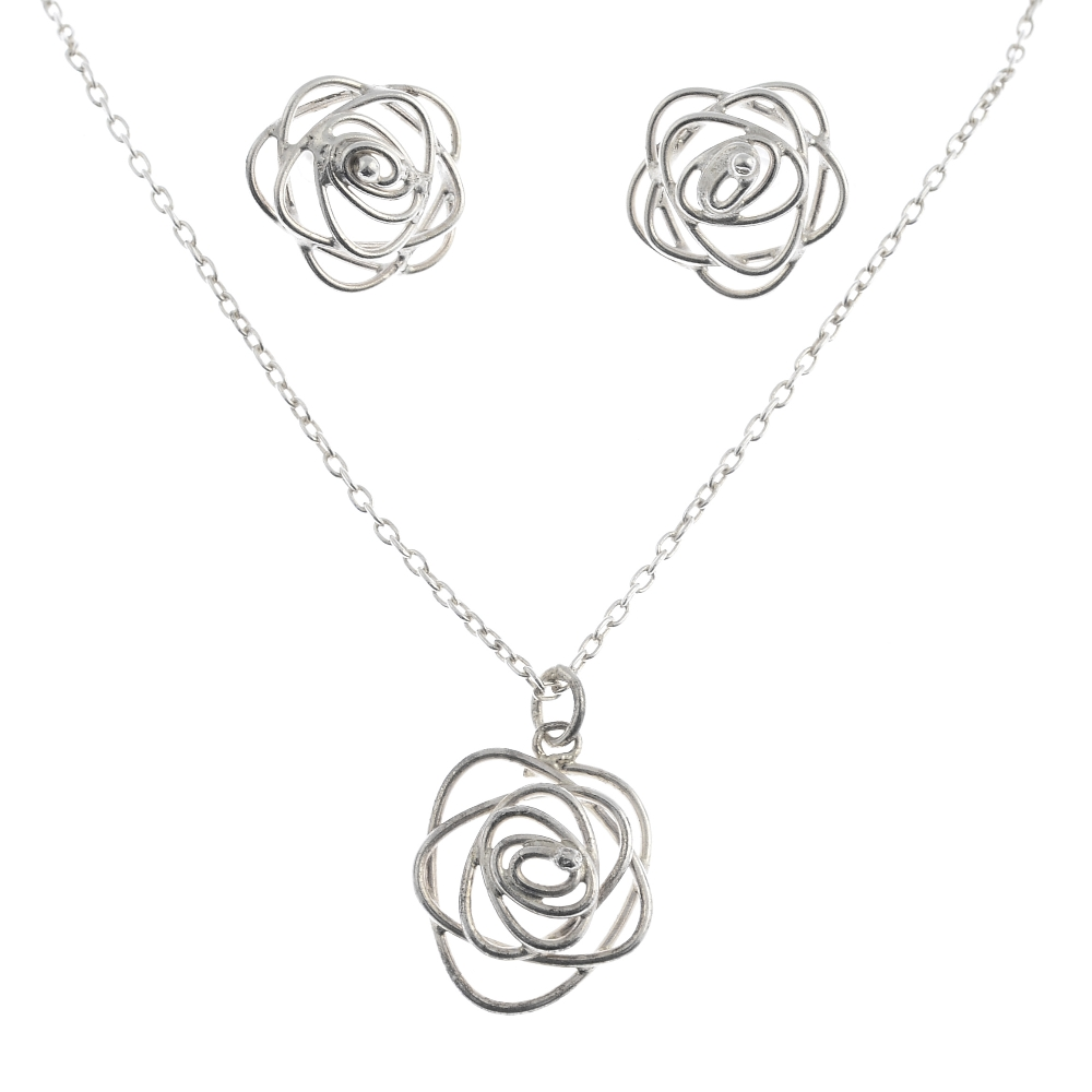 Lot 57 - A selection of silver and white metal jewellery. To include a pendant and earring set featuring a
