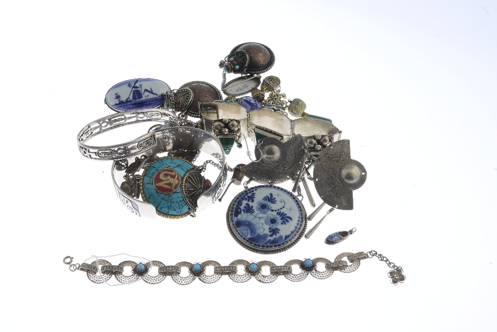 Lot 22 - A selection of international silver and costume jewellery. To include a chrysocolla brooch and