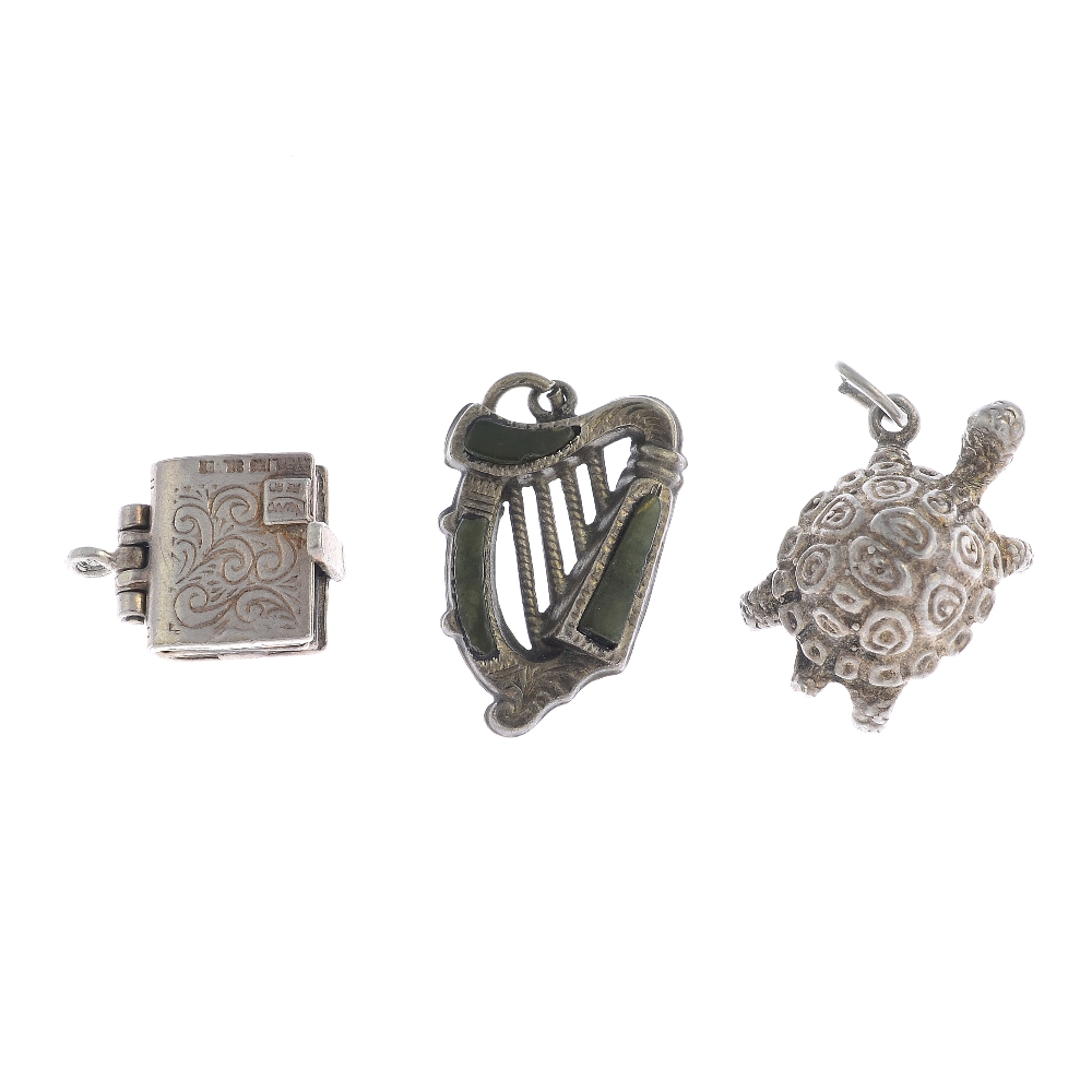 Lot 21 - Ten silver and white metal charm bracelets and further charms. To include a silver and serpentine