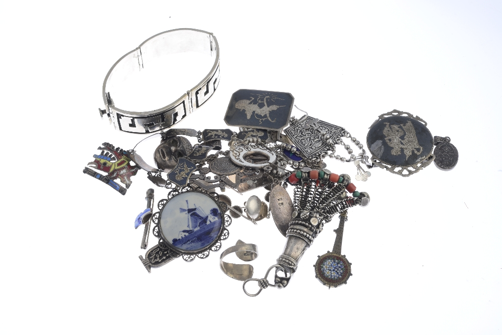 Lot 17 - A selection of international silver and white metal jewellery. To include a Russian cloisonné enamel