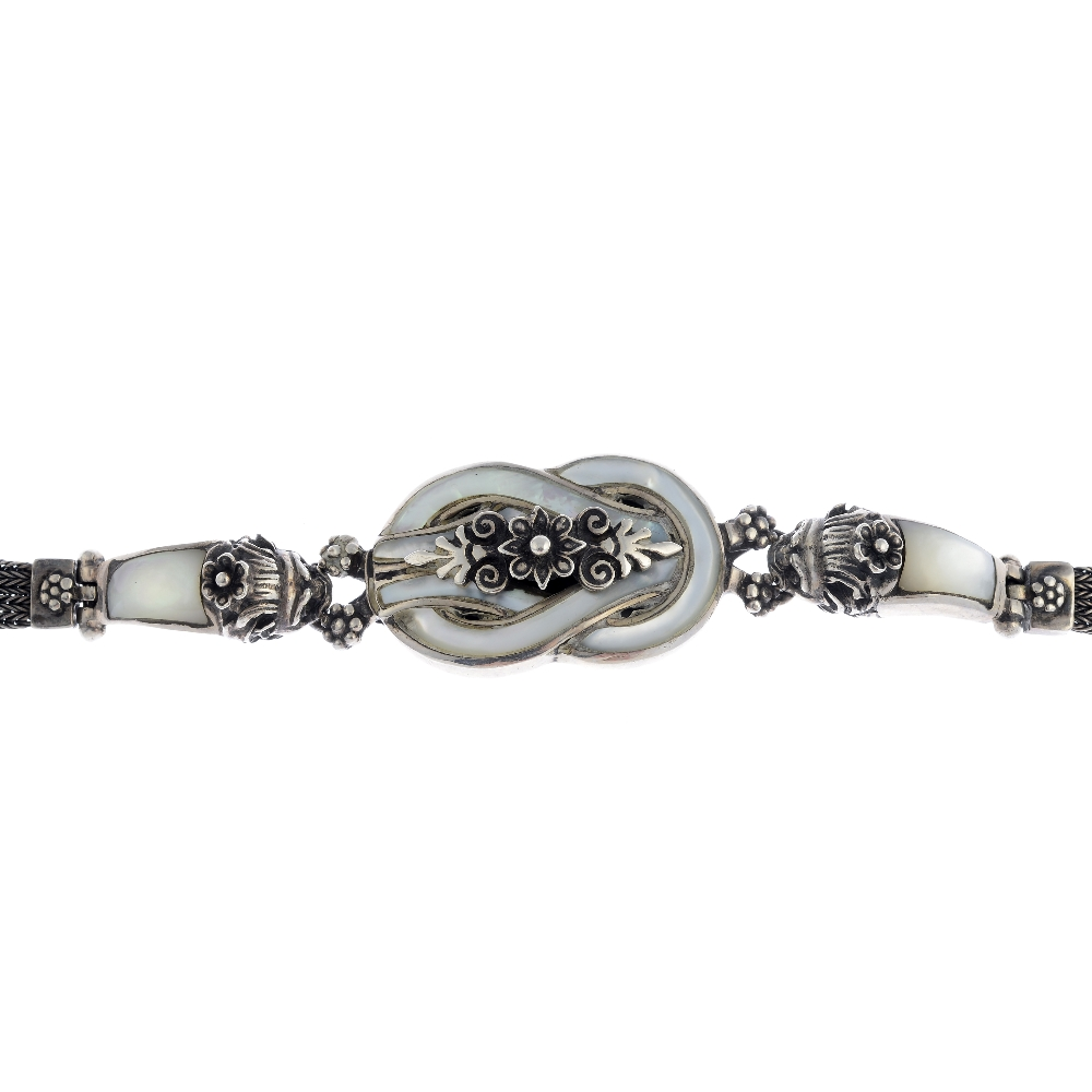 Lot 44 - A selection of silver and white metal jewellery. To include a mother of pearl bracelet featuring a