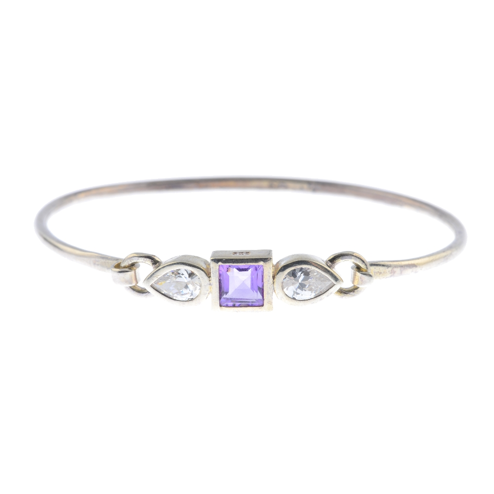 Lot 51 - A selection of silver and white metal jewellery. To include an amethyst bangle of Celtic design with