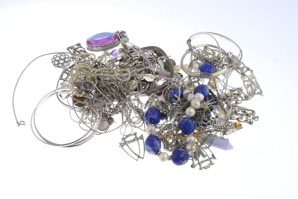 Lot 52 - A selection of silver and white metal jewellery. To include a moonstone bracelet of a series of