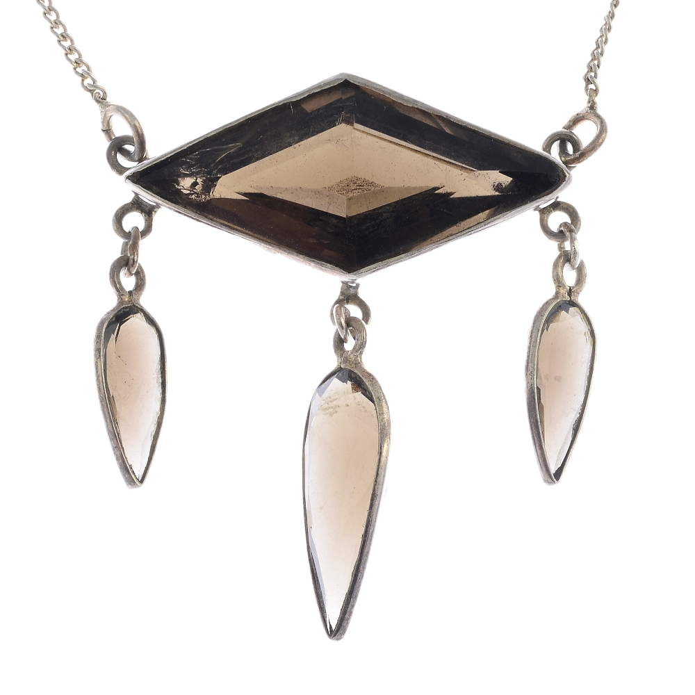 Lot 39 - A selection of silver and white metal jewellery. To include a smoky quartz necklace featuring a kite