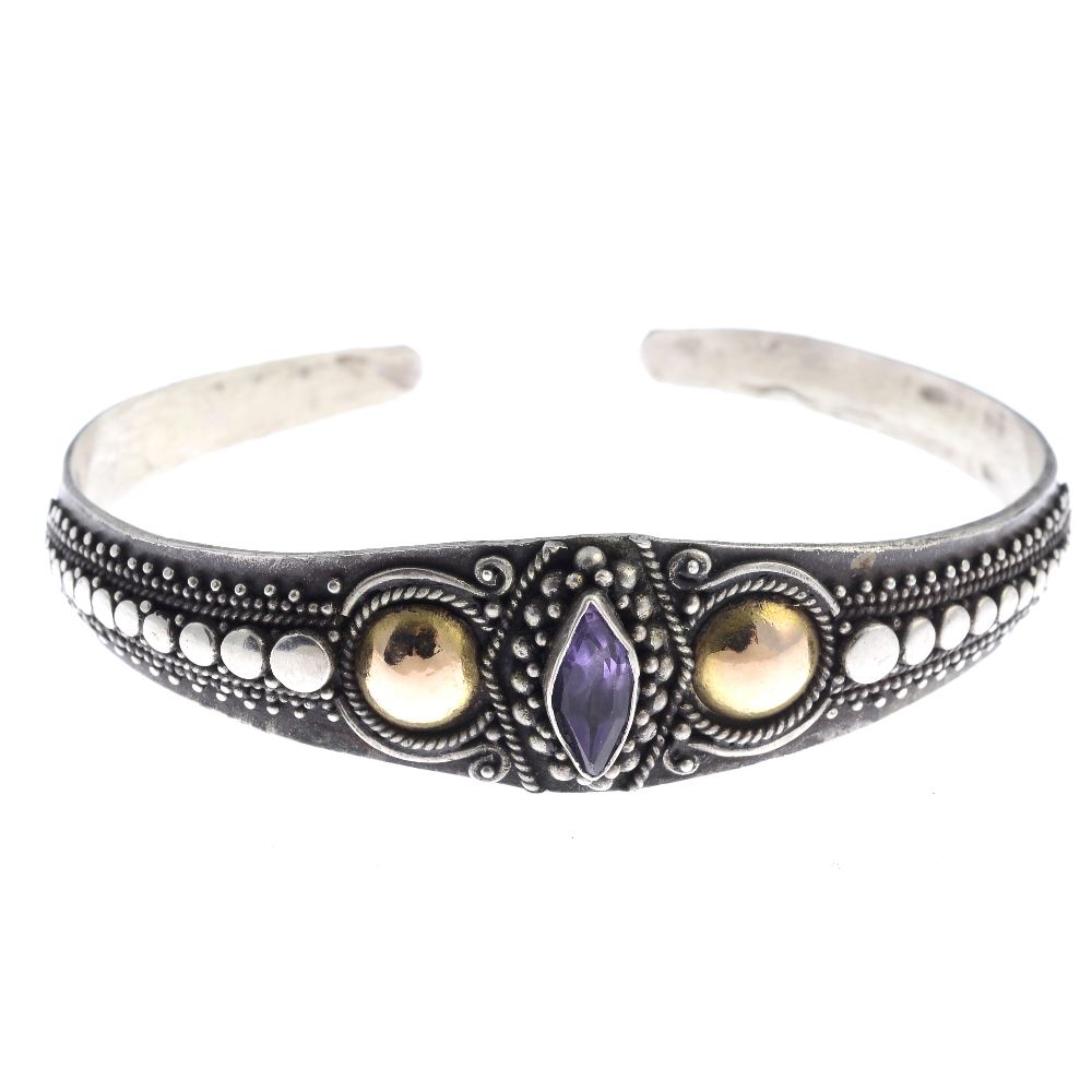 Lot 60 - A selection of silver and white metal bangles. To include an amethyst torque bangle featuring