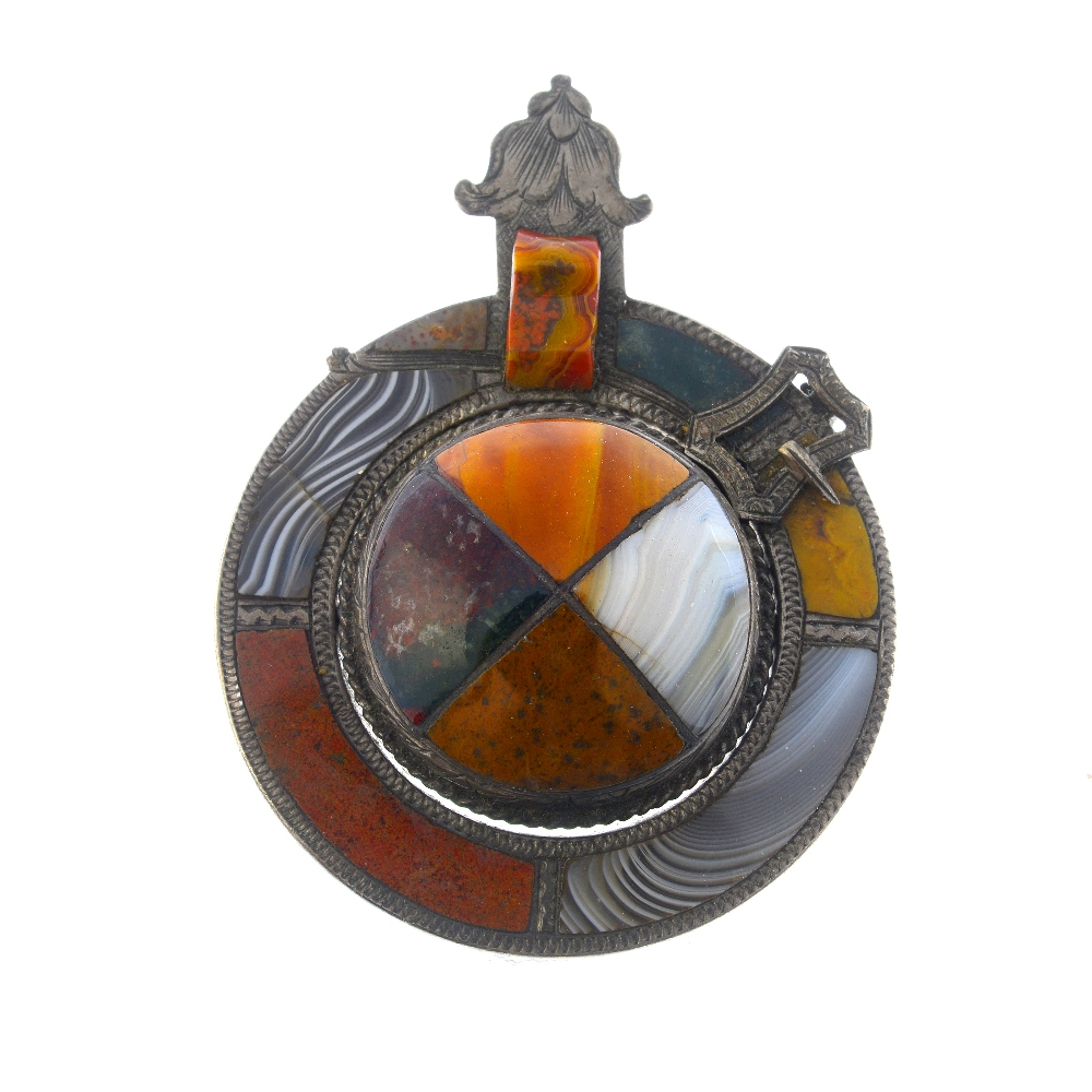 Lot 12 - A selection of mainly Scottish silver and white metal brooches. To include an agate brooch of