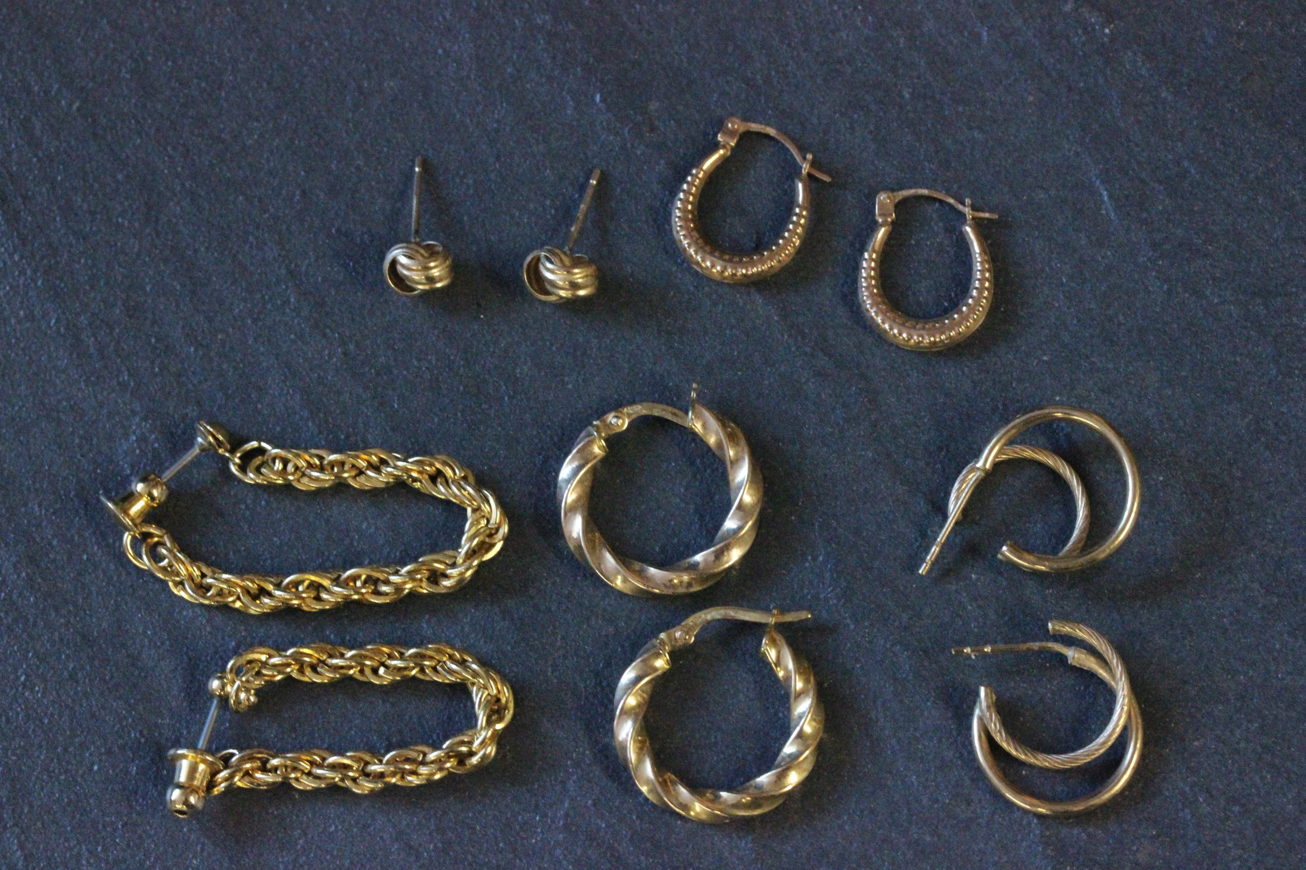 Lot 32 - Two pair of 9 carat gold earrings, along with three other pair of earrings